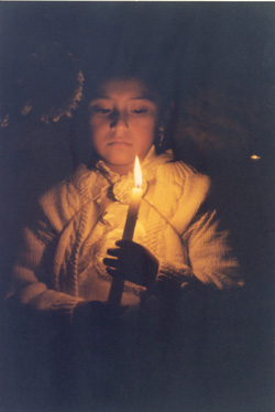 girl holding a light at a festival