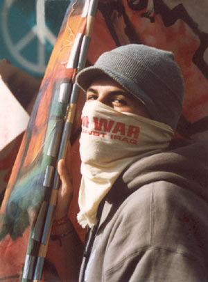 masked youth against the iraq war